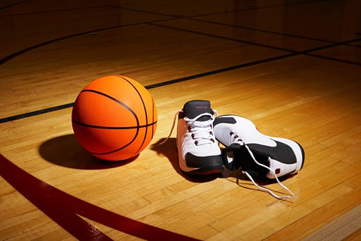 Basketball and sports shoes on basketball court : Stock Photo