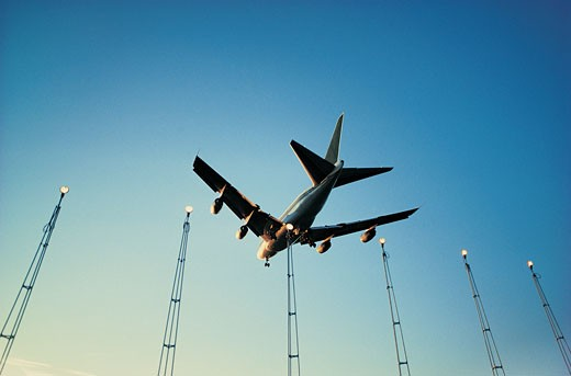Plane Landing, Backlit Against Clear Blue Sky : Stock Photo