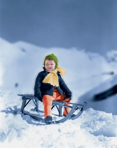 Child on a Bobsled : Stock Photo