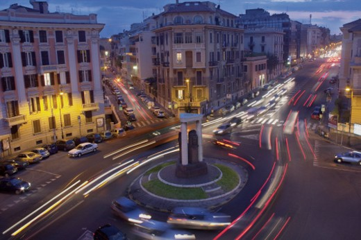 Stock Photo: 1598R-9951050 Long Exposure Shot of Cars Going Around a Roundabout in Rome, Italy