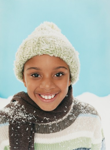 Stock Photo: 1598R-9951690 Studio Portrait of a Smiling Young Boy in a Woolen Hat and Scarf