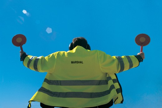 Low Angle Rear View of a Ground Crew Airport Worker : Stock Photo