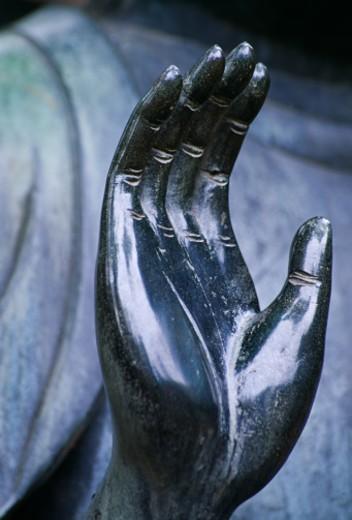 Bronze Bhudda, close-up of hand : Stock Photo