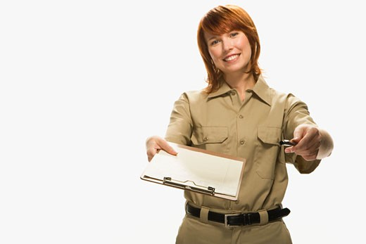 Delivery woman requesting signature on white background, portrait : Stock Photo