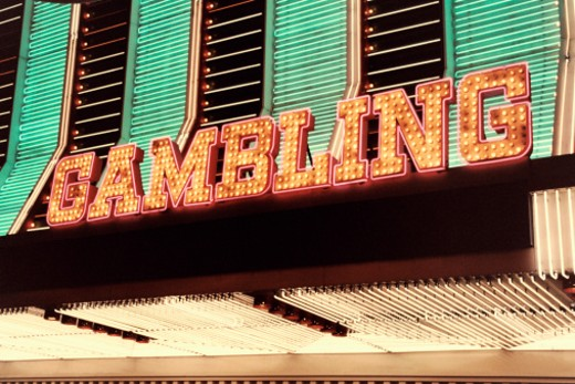 Stock Photo: 1598R-9956320 Bright Neon Gambling Sign