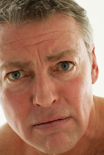 Stock Photo: 1598R-9956610 Mature man with scared expression, portrait, close-up