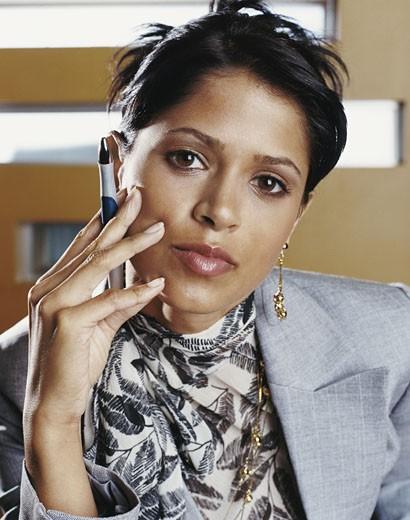 Stock Photo: 1598R-9956869 Portrait of a Confident Businesswoman Holding a Pen