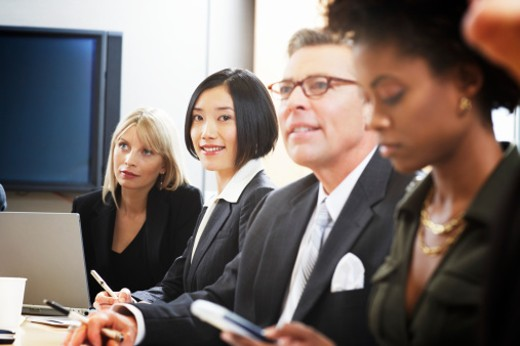 Stock Photo: 1598R-9956934 Businessmen and women in meeting, close-up