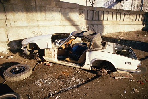 Stock Photo: 1598R-9957518 Abandoned trashed car