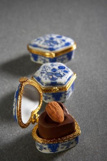 Almond chocolate in decorative box : Stock Photo