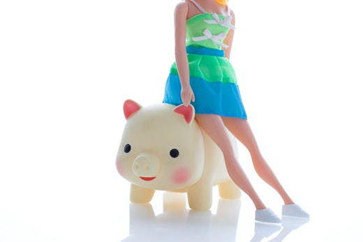Stock Photo: 1598R-9958400 Female figure sitting on model pig