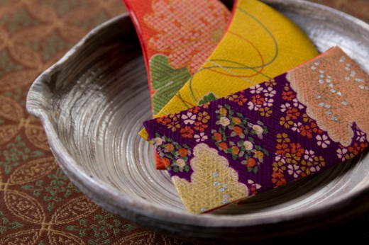 Stock Photo: 1598R-9958592 Pieces of Japanese fabric in bowl, close-up
