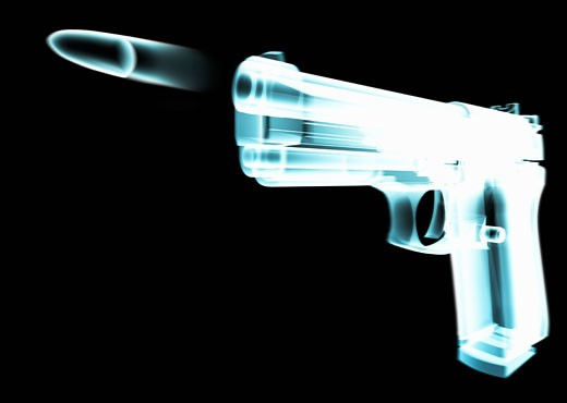 Stock Photo: 1598R-9958734 X-ray of gun firing bullet (digital composite)