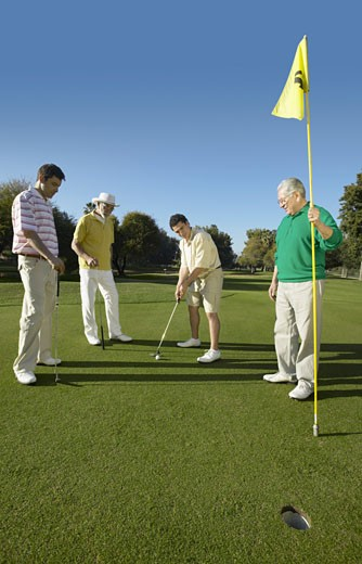 Stock Photo: 1598R-9959317 Young and Old Men on a Putting Green Playing Golf