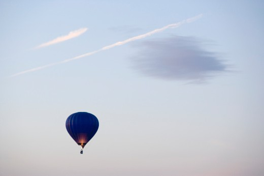 Stock Photo: 1598R-9959560 Hot air balloon floating in sky
