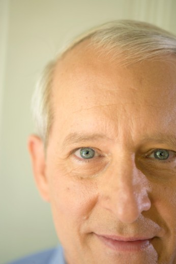 Stock Photo: 1598R-9959591 Senior man smiling, portrait, close-up (cropped)