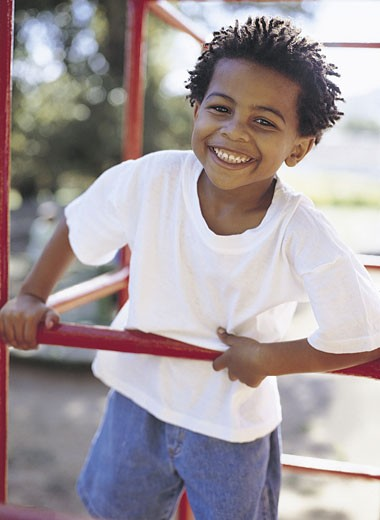 Stock Photo: 1598R-9960284 Boy Playing on Jungle Gym