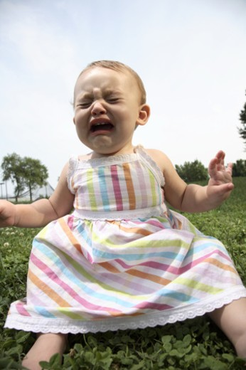 Baby girl (18-21 months) in dress crying : Stock Photo
