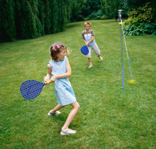 Two Children Playing Paddle Ball : Stock Photo