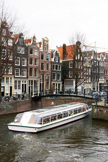 Holland, Amsterdam, boat on canal : Stock Photo