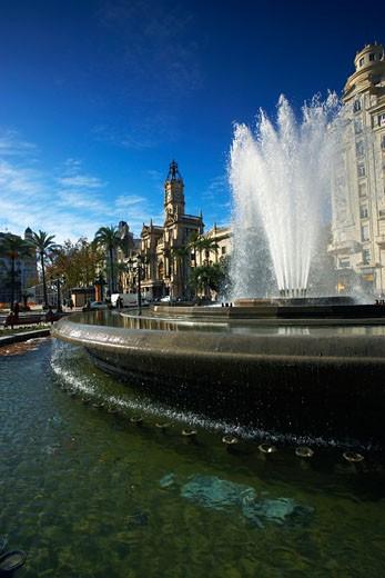 Stock Photo: 1598R-9963621 Spain, Valencia, fountain in Plaza del Ayuntamiento