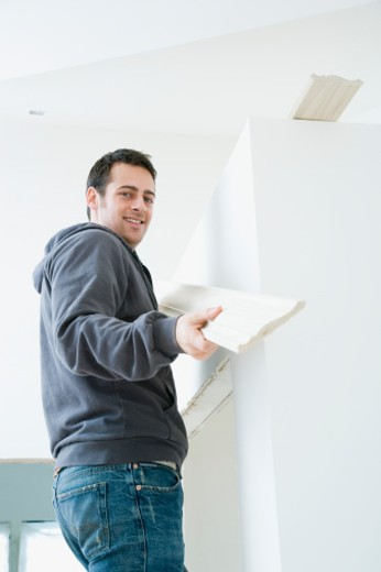 Stock Photo: 1598R-9964661 Young Man Decorating Room, Portrait