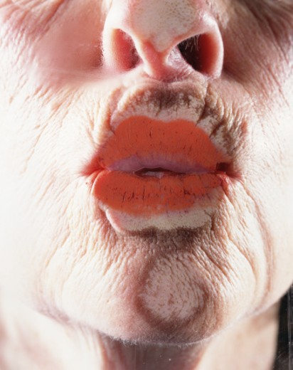 Stock Photo: 1598R-9964671 Senior woman puckering lips, close-up