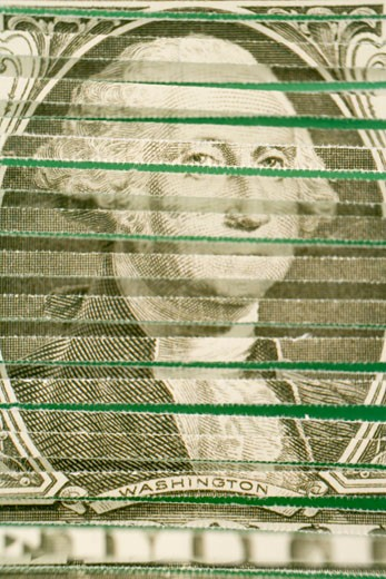 Shredded George Washington on US currency banknote, close-up : Stock Photo