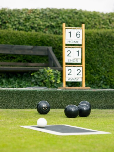 Bowling Balls on a Bowling Green and a Scoreboard : Stock Photo