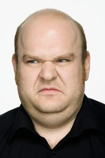 Stock Photo: 1598R-9968040 Man making face, close-up