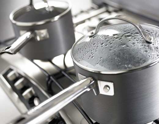 Close up of a Pan on Cooker, Steam on Lid : Stock Photo
