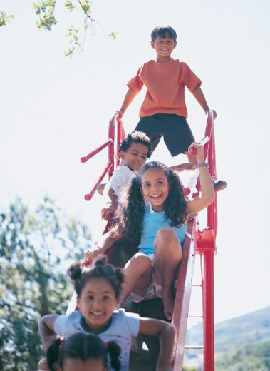Stock Photo: 1598R-9969004 Group of Children Playing on Slide
