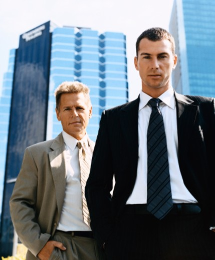 Stock Photo: 1598R-9969304 Businessmen Standing Outdoors in a City Wearing Full Suits
