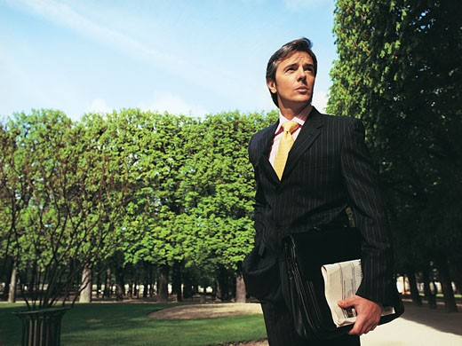 Businessman Standing in Luxembourg Gardens, Paris : Stock Photo