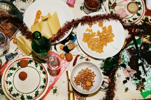 Stock Photo: 1598R-9969651 Messy Table of Christmas Party Food and Decorations