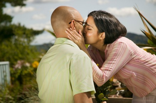 Woman kissing man : Stock Photo