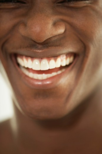 Young man smiling, portrait, close-up : Stock Photo