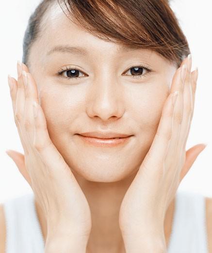 Stock Photo: 1598R-9971226 Woman Applying Facial Cream
