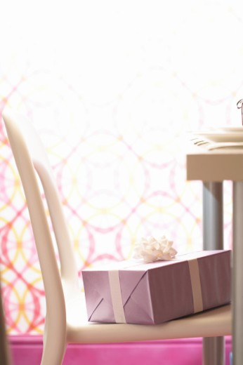 Stock Photo: 1598R-9971819 Gift on chair