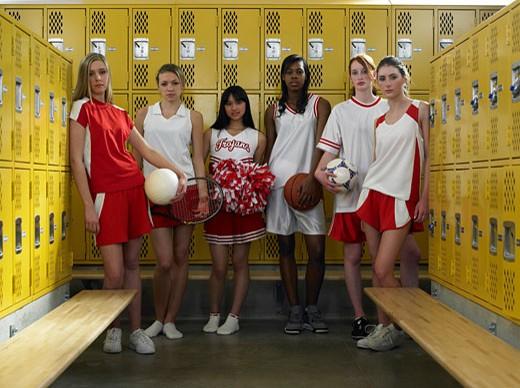 Stock Photo: 1598R-9971988 Group of teenage girls (15-17) standing in locker room, portrait