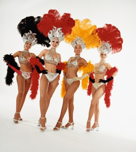 Portrait of Four Chorus Girls, Wearing full Stage Costume and Standing in a Row : Stock Photo