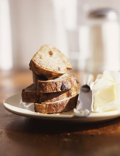 Stock Photo: 1598R-9975776 Still Life of Bread and Butter on a Plate