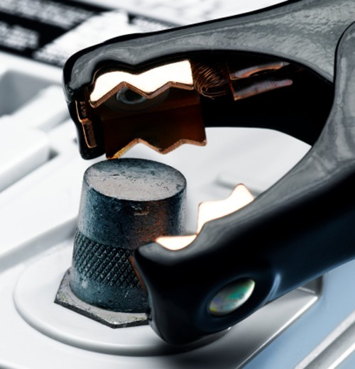 Jumper cable connecting to negative terminal on car battery, close-up : Stock Photo