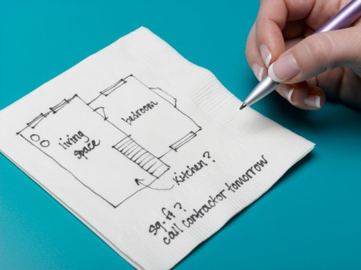 Woman drawing home improvement design on napkin, close-up : Stock Photo
