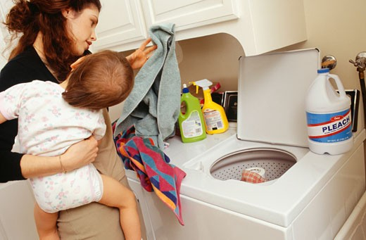 Mother and child (21-24 months) doing laundry : Stock Photo