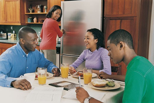 Stock Photo: 1598R-9979266 Family Sitting at a Table for Breakfast