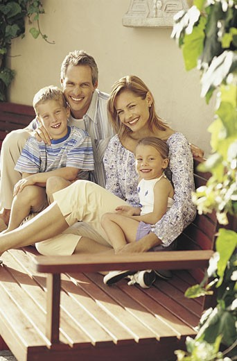 Stock Photo: 1598R-9980165 Portrait of Family on Holiday Sitting on a Bench