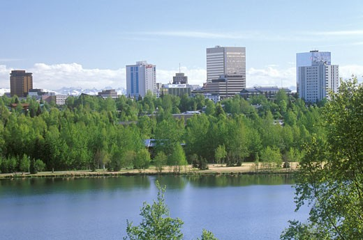 Stock Photo: 1598R-9980433 Skyline of Anchorage with Lake Spenard in the foreground and Mt. Hood in the back