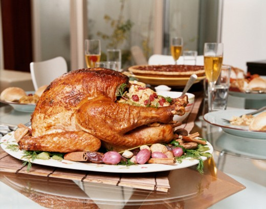 Roast Turkey and Stuffing on a Dining Room Table for  Thanksgiving Dinner : Stock Photo