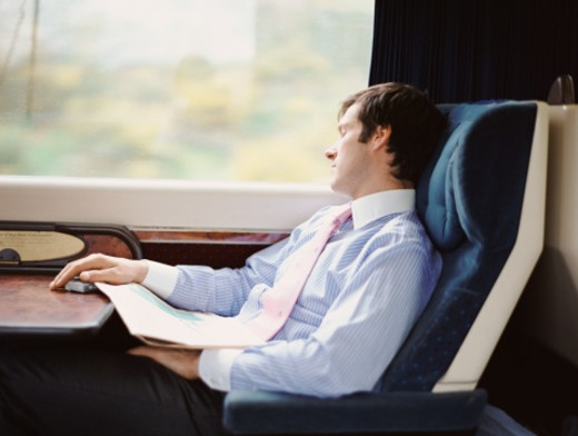 Stock Photo: 1598R-9982684 Businessman Asleep in His Seat on a Passenger Train